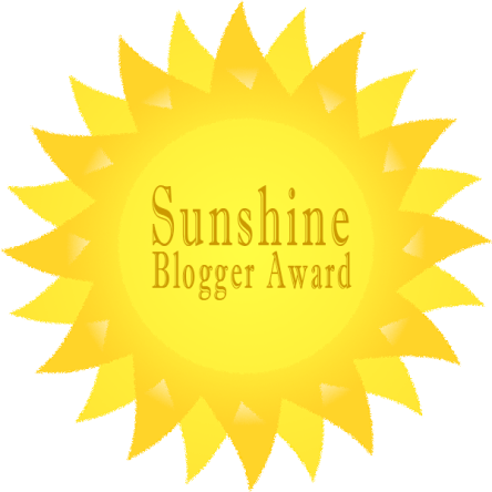 This image has an empty alt attribute; its file name is sunshine-blogger-award.png